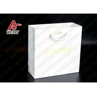 Cheap Bright Golden Reusable Promotional Paper Bags For Retail Embossed LOGO for sale