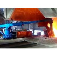 Robotic arm for feeding scrap material into IF induction furnace