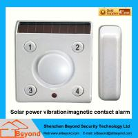 Solar power vibration magnetic contact alarm with rechargeable Li-Ion backup batter